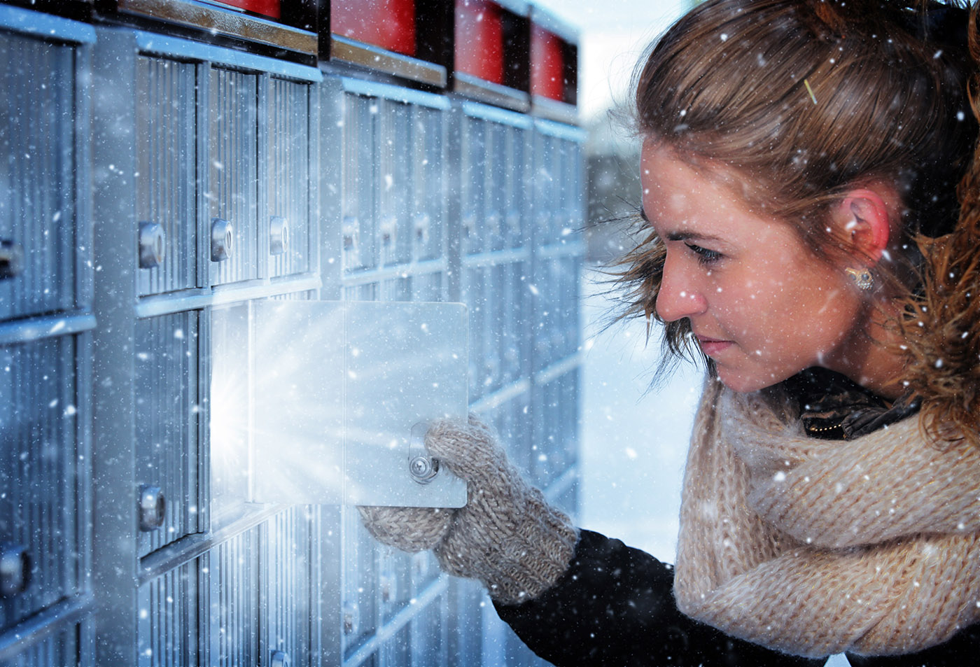 Pretty Woman Looking at Highlighted Mailbox in Winter - stock photos and royalty-free images